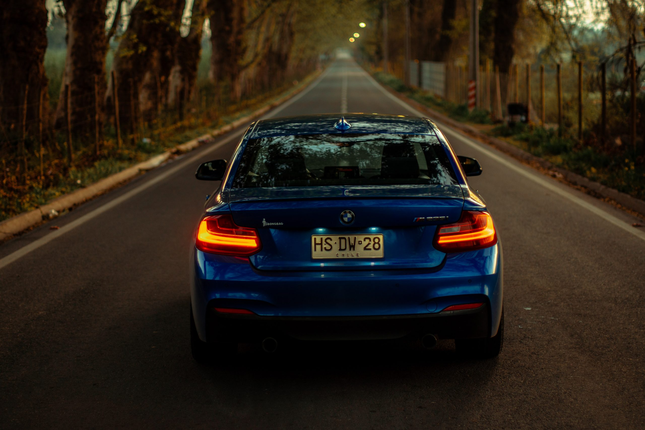 bmw m235i blue in road